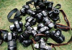 a lot of cameras laying on the ground