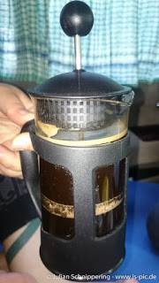A french press filled with coffee