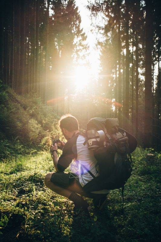 Backpacker sitting in the forest