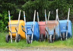 Wheel barrows waiting for the next job