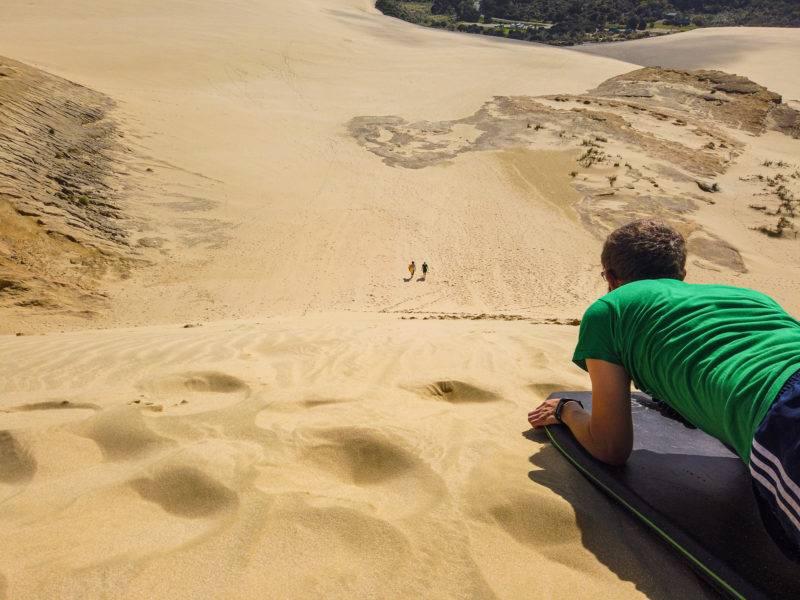 Sliding down on a sandboard