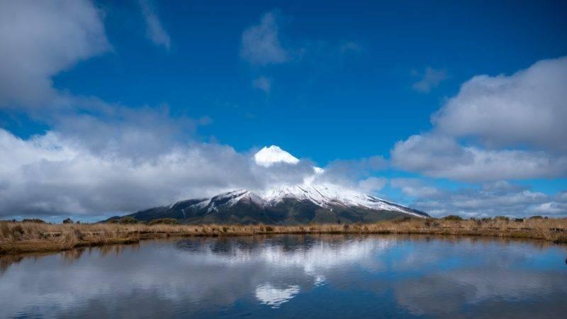 Reflection of Mount Taranaki in the tarn