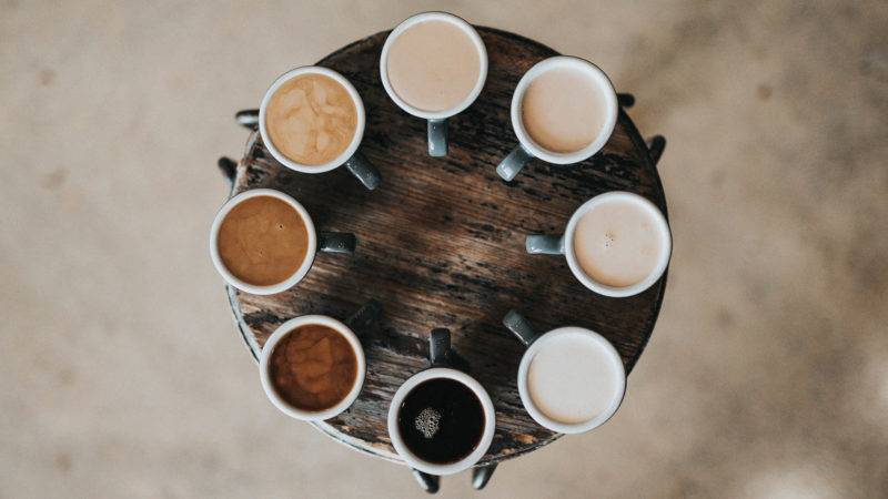 Different Coffee varieties set up on a round wooden table